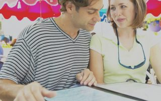 Store marketing during holiday events shows young couple looking at a menu. There's a colorful, festive-looking background.
