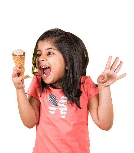 Turn bad news into happiness image shows little girl holding an ice cream cone. She is wearing a melon colored shirt and has a huge smile on her face.